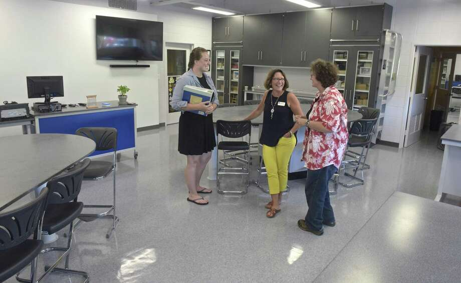 Laurie Doss, right, Science department Chair, talks with Caitlin Lynch, Assistant Head of School and Director of Communications, and Marissa Hansen, first year biology teacher, left, in a renovated science lab at Marvelwood School, in Kent. The school just completed a multi-million dollar renovation on the science labs, dorms and student commons. Thursday, September 6, 2018, Kent, Conn. Photo: H John Voorhees III / Hearst Connecticut Media / The News-Times