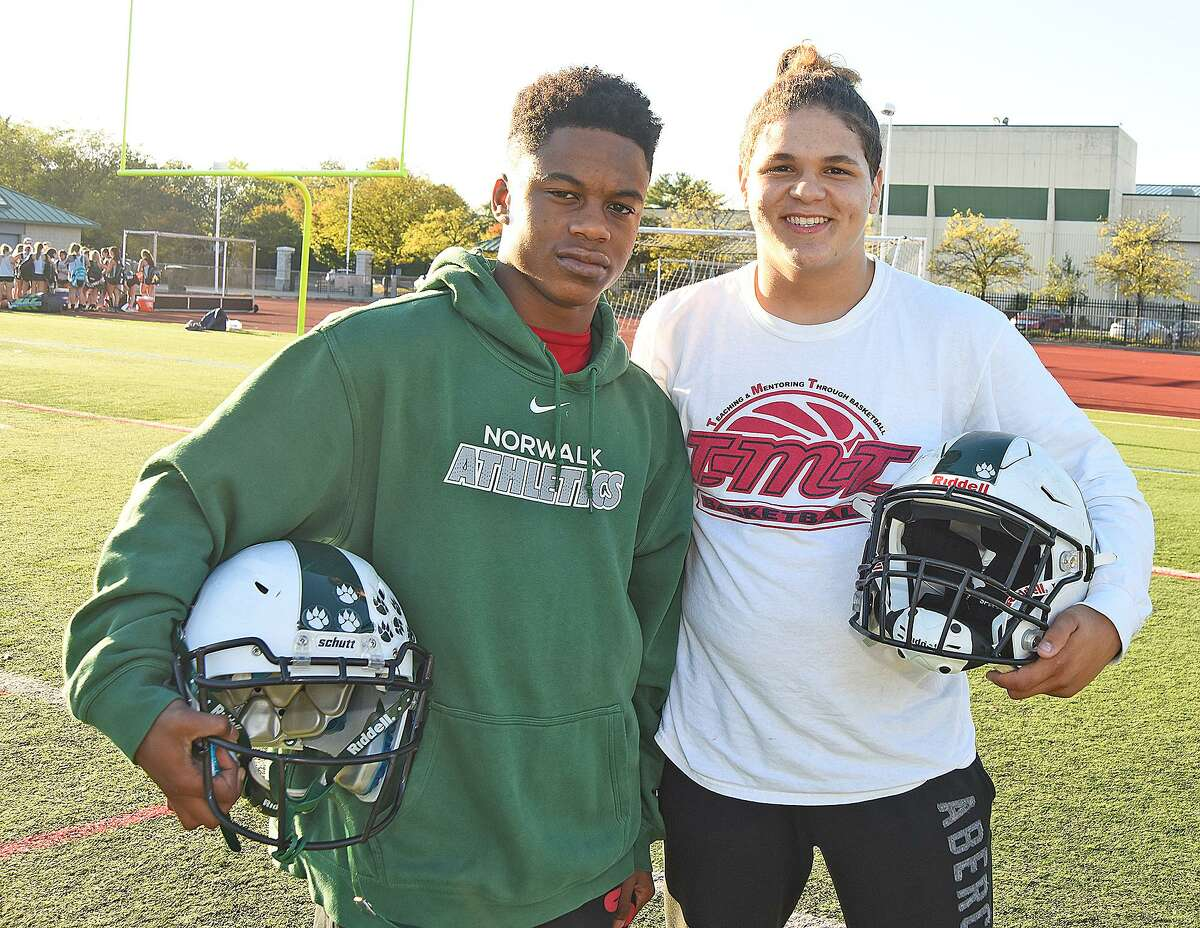 Khalil Eason, left, and Izayah Valentine are two freshmen who have made their way into the starting lineup of the Norwalk High football team.