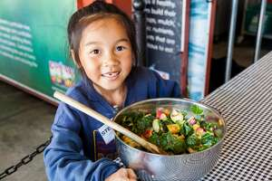 Elementary school children visit the Ferry Plaza Farmers Market each week to meet farmers, learn cooking skills and try different fruits and vegetables as part of CUESA's program, Foodwise Kids.