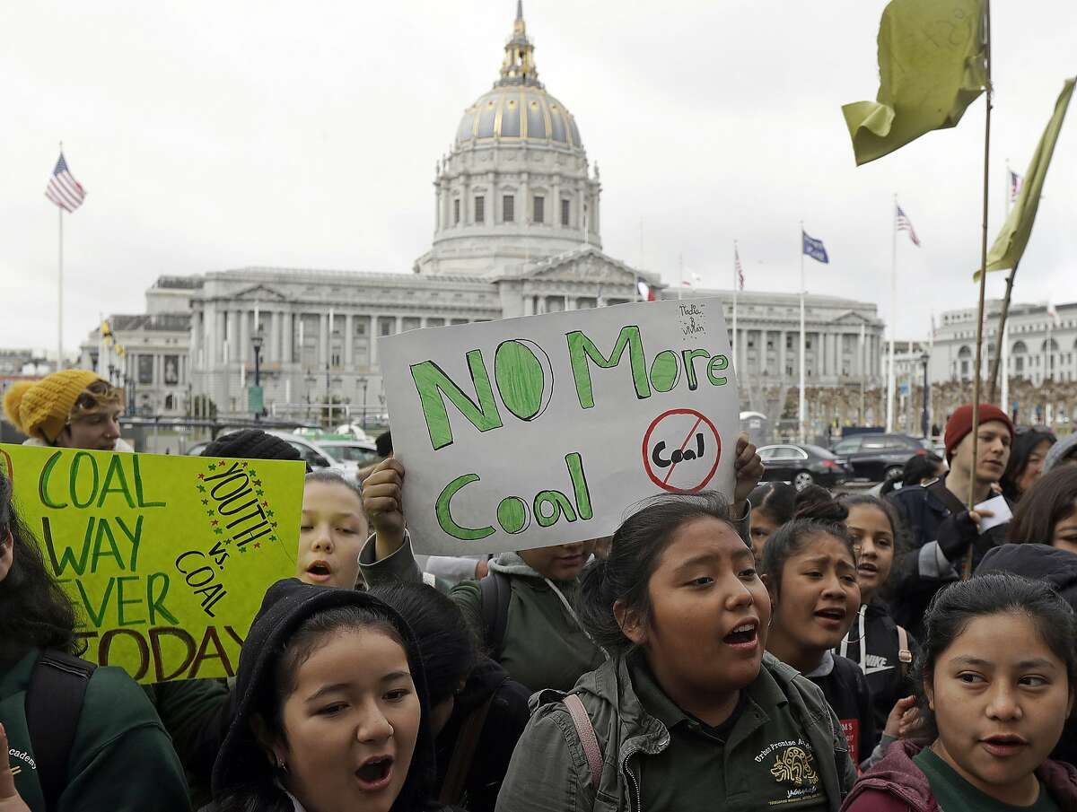 """FILE - In this Feb. 28, 2018 file photo, students rally for clean energy in front of San Francisco City Hall. A federal judge presiding over lawsuits accusing big oil companies of lying about global warming is turning his courtroom into a classroom. U.S. District Judge William Alsup has asked lawyers for two California cities and five of the world's largest oil and gas companies to come to court on Wednesday, March 21, 2018 to present """"the best science now available on global warming."""" (AP Photo/Jeff Chiu, File)"""