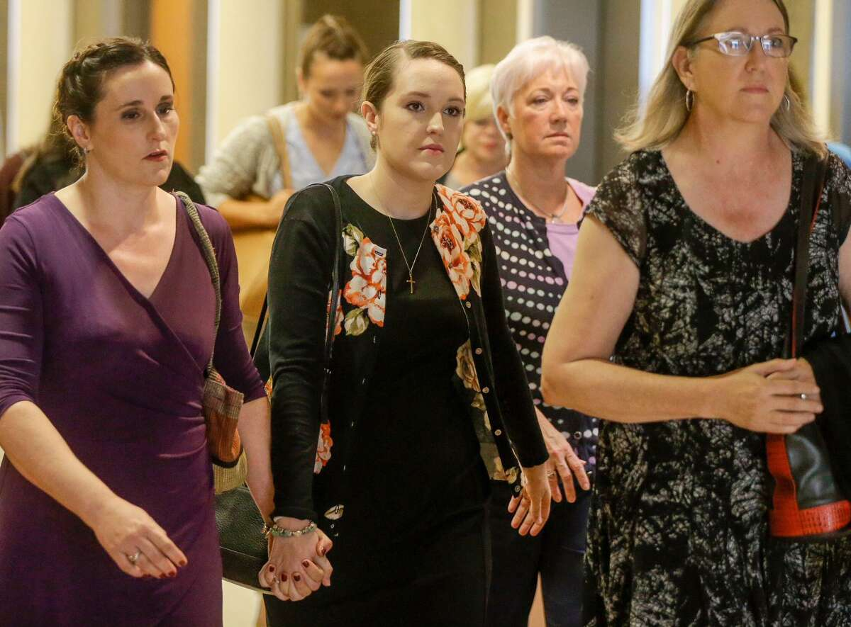 Schiffer, center, who taught at Cypress Springs High School, arrives for sentencing at the 177th District Criminal Court Tuesday, Aug. 21, 2018 in Houston after pleading guilty to one charge of improper relationship with a student. She admitted to meeting with a former student for sex at least twice during the summer of 2017, according to court records.