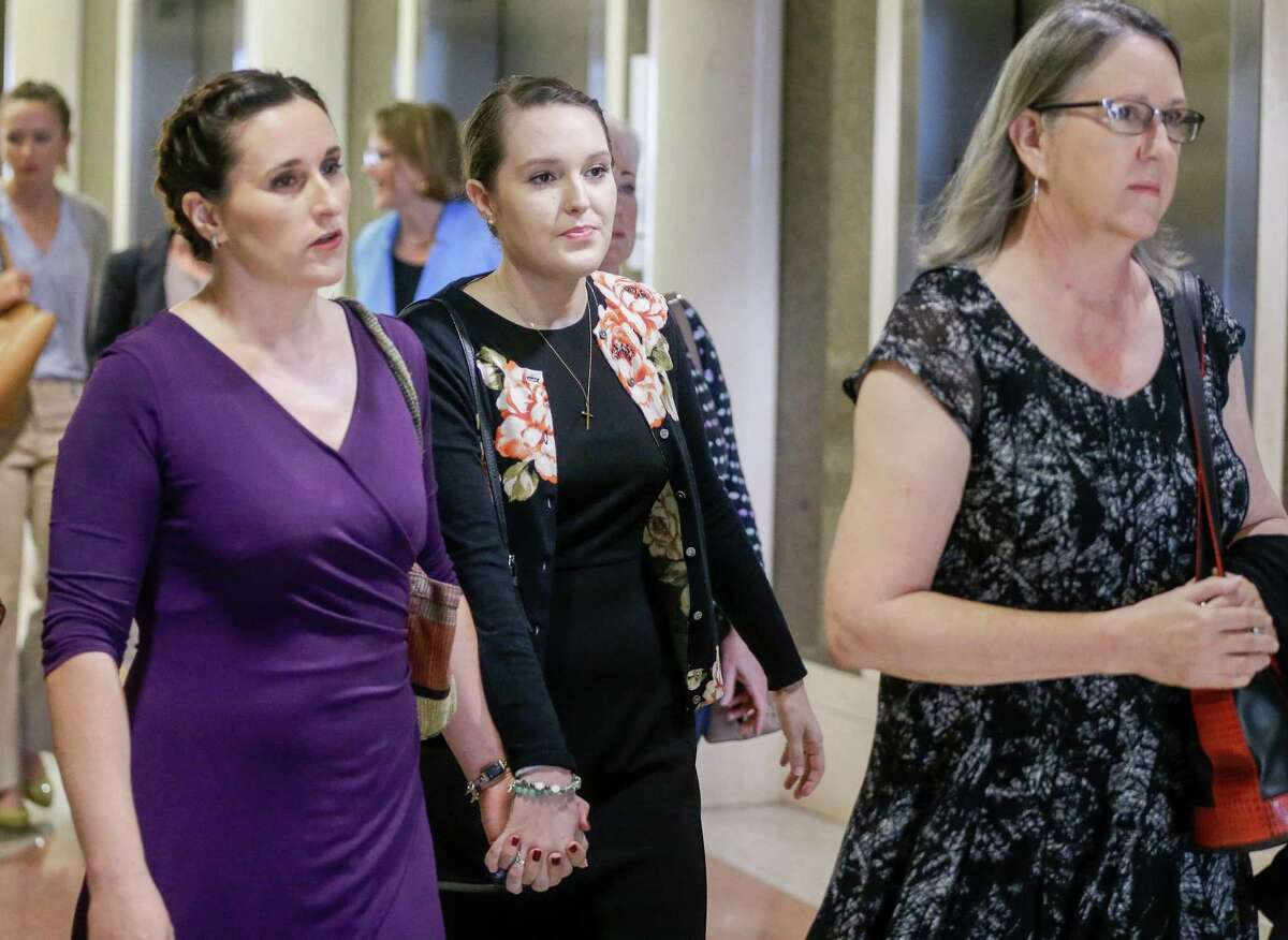 Michelle Schiffer, center, who taught at Cypress Springs High School, arrives for sentencing at the 177th District Criminal Court Tuesday, Aug. 21, 2018 in Houston after pleading guilty to one charge of improper relationship with a student. She admitted to meeting with a former student for sex at least twice during the summer of 2017, according to court records.