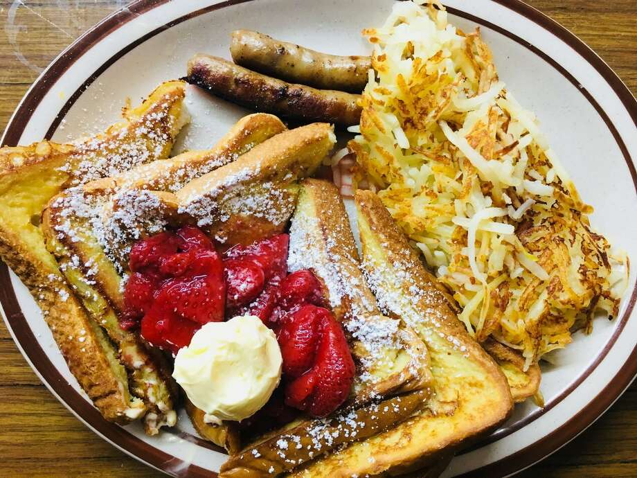 Diners can order French toast topped with strawberries with a side of hash browns and sausage at Huffman Cafe. Photo: Huffman Cafe