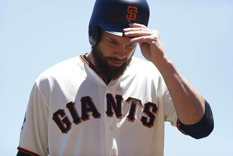 Brandon Belt (9) comes off the field at the Giants vs. Miami Marlins game at the AT&T Park on Wednesday, June 20, 2018 in San Francisco, Calif. Photo: Liz Moughon / The Chronicle