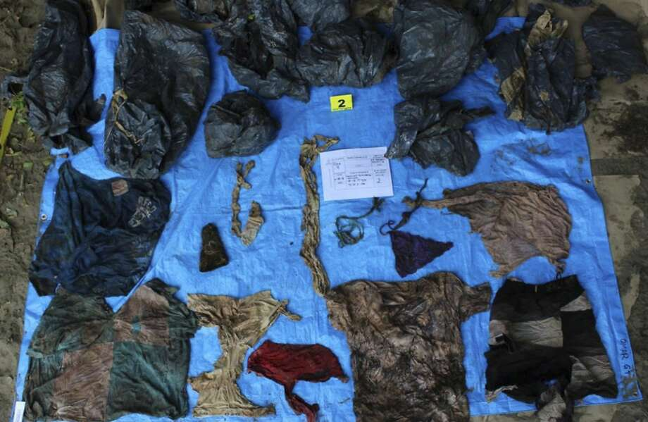 In this undated photo provided by the Veracruz State Prosecutor's Office shows clothing items found at the site of a clandestine burial pit in the Gulf coast state of Veracruz, Mexico. Veracruz state prosecutor Jorge Winckler said the bodies were buried at least two years ago and did not rule out finding more remains. He said investigators had found 114 ID cards in the field, which held about 32 burial pits. (Veracruz State Prosecutor's Office via AP) Photo: Associated Press