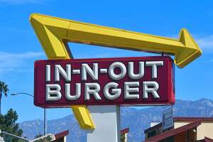 The signs points to an In-N-Out Burger restaurant in Alhambra, California on August 30, 2018. - Califoria's Democratic Party Chairman, Eric Bauman, is calling for a boycott of the Irvine, CA based fast food chain after it donated $25,000 to help California Republicans in November. In addition to this week's donation, In-N-Out donated $30,000 to the GOP in 2017 and 2016. (Photo by Frederic J. BROWN / AFP)FREDERIC J. BROWN/AFP/Getty Images