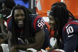 Houston Texans defensive end Jadeveon Clowney (90) laughs with wide receiver DeAndre Hopkins (10) on the bench during the fourth quarter of an NFL preseason game at NRG Stadium, Saturday, August 18, 2018, in Houston.