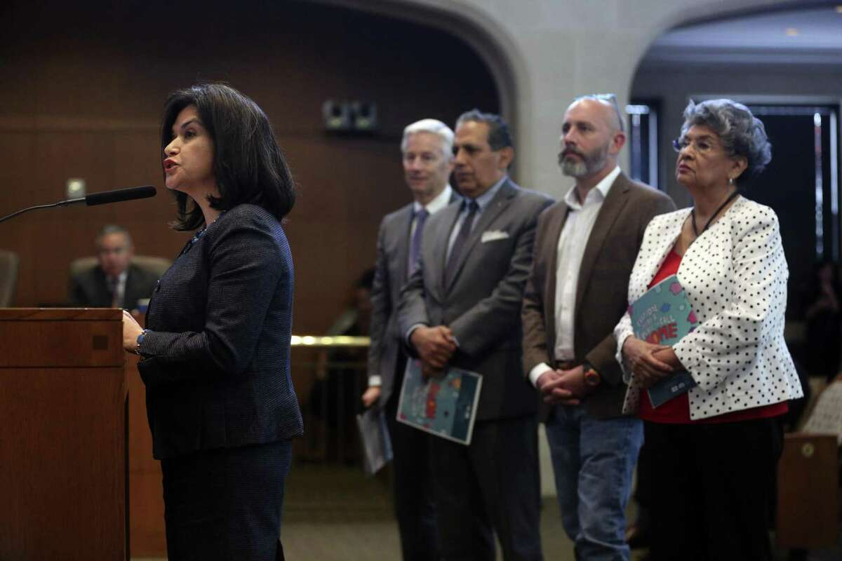 Mayor's Housing Policy Task Force Chair Lourdes Castro Ramírez, left, flanked by other members of the task force, speaks to San Antonio City Council on Thursday as council members consider adopting that panel's recommendations.
