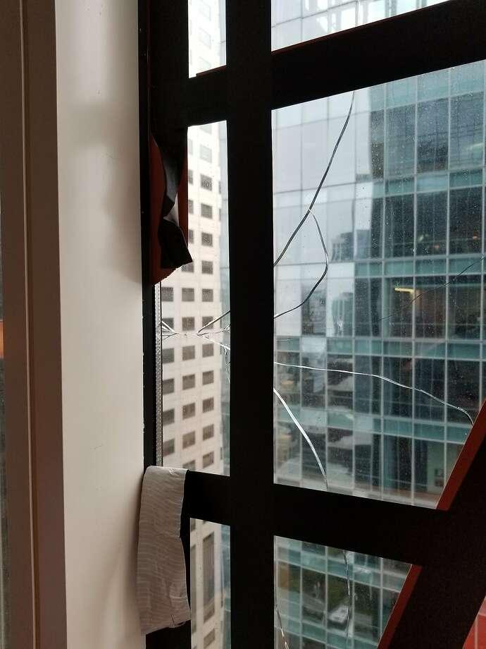 The broken window in San Francisco's tilting Millennium Tower. Photo: San Francisco Department Of Building Inspection
