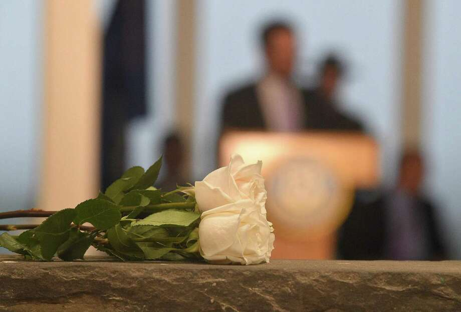 Roses sit perch atop a wall as Gov. Dannel Malloy addresses families, friends and state officials during the Connecticut Remembers September 11th Memorial Ceremony at Sherwood Island State Park in Westport, Conn. on Thursday Sept. 6, 2017. The event remembers the 161 victims with ties to Connecticut. Photo: Matthew Brown / Hearst Connecticut Media / Stamford Advocate