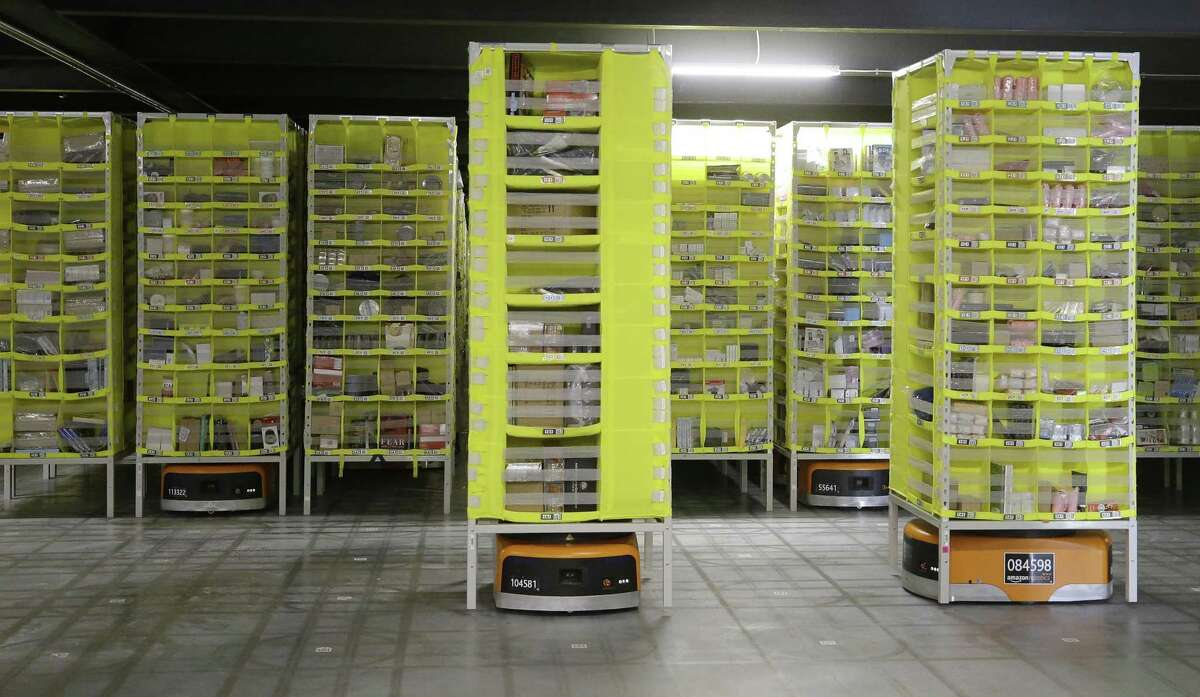 Items are moved robotically at the Amazon HOU2 Fulfillment Center, 10550 Ella Blvd., Thursday, Sept. 6, 2018, in Houston.