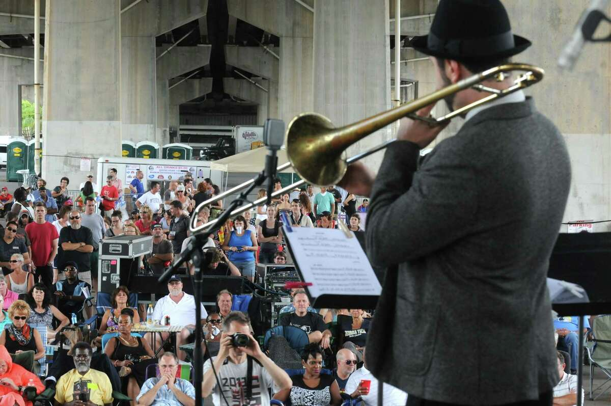 Rob Edwards trombonist with the Professor Cunningham and His Old School band plays during the Albany Riverfront Jazz Festival at the Corning Preserve on Saturday Sept. 6, 2014 in Albany, N.Y. (Michael P. Farrell/Times Union)