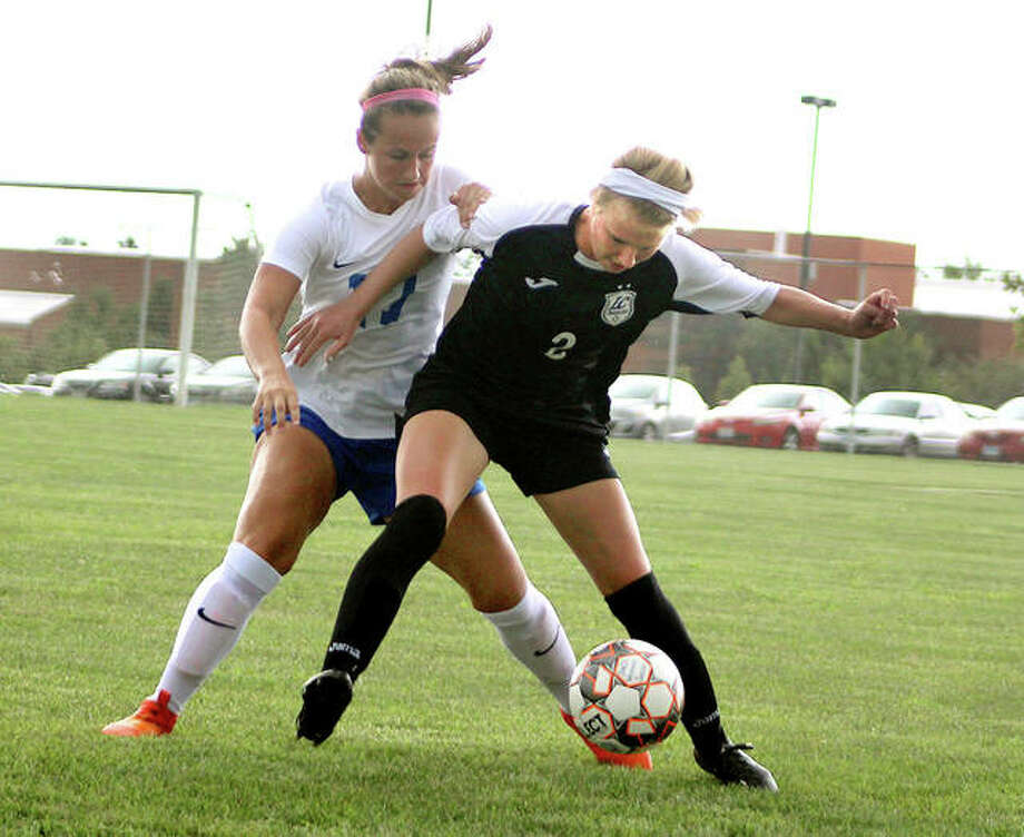 LCCC'S Taylor Hansen, front, shields the ball from SWIC's Addison Hanusek during Region 24 soccer action Thursday in Belleville. Photo: Pete Hayes | The Telegraph