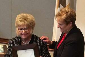 Director of the Illinois Department of Aging Jean Bohnhoff presents Madison County Board member Helen Hawkins, of Granite City, with a letter of recognition by Gov. Bruce Rauner during her induction into the Illinois Senior Hall of Fame this past February.