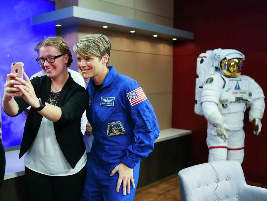 NASA astronaut Anne McClain takes a photo with a NASA intern following a news conference discussing her crew's upcoming mission to the International Space Station at NASA's Johnson Space Center, Thursday, Sept. 6, 2018. The crew is scheduled to launch Dec. 20 aboard the Soyuz MS-11 spacecraft from the Baikonur Cosmodrome in Kazakhstan. Photo: Mark Mulligan, Staff Photographer / © 2018 Mark Mulligan / Houston Chronicle