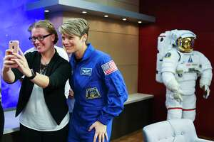 NASA astronaut Anne McClain takes a photo with a NASA intern following a press conferencing discussing her crew's upcoming mission to the International Space Station in a news conference at NASA's Johnson Space Center, Thursday, Sept. 6, 2018 in Houston. The crew is scheduled to launch Dec. 20 aboard the Soyuz MS-11 spacecraft from the Baikonur Cosmodrome in Kazakhstan.