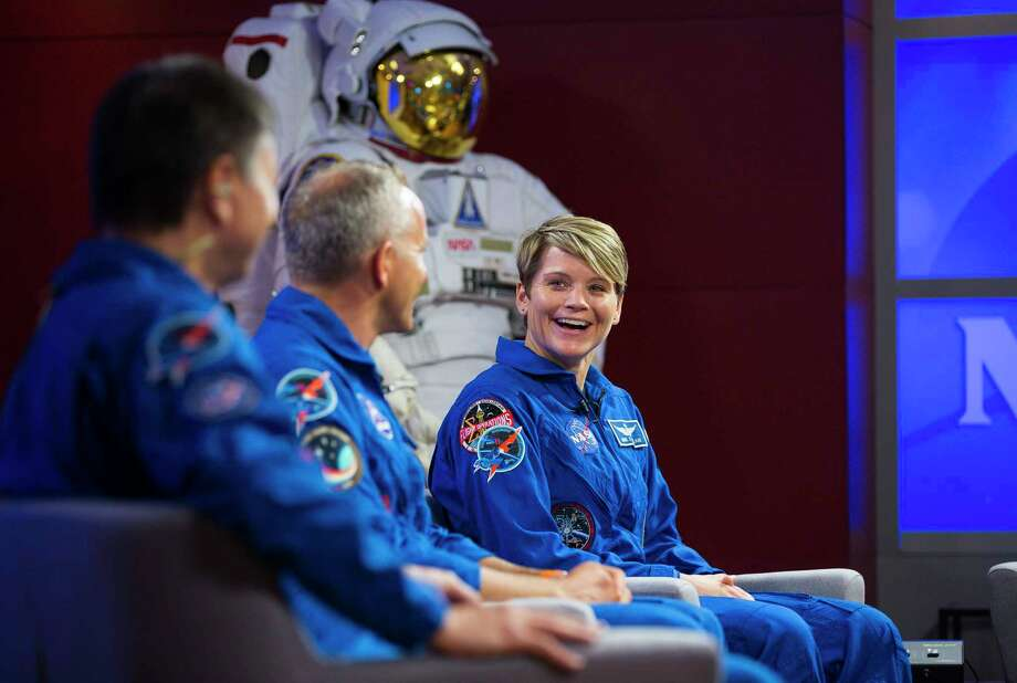 NASA astronaut Anne McClain (far right), along with her crewmates David Saint-Jacques of the Canadian Space Agency and Oleg Kononenko of the Russian space agency Roscosmos, discuss their upcoming mission to the International Space Station in a news conference at NASA's Johnson Space Center, Thursday, Sept. 6, 2018 in Houston. The crew is scheduled to launch Dec. 20 aboard the Soyuz MS-11 spacecraft from the Baikonur Cosmodrome in Kazakhstan. Photo: Mark Mulligan, Staff Photographer / © 2018 Mark Mulligan / Houston Chronicle