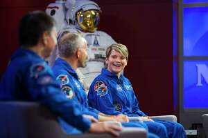 NASA astronaut Anne McClain (far right), along with her crewmates David Saint-Jacques of the Canadian Space Agency and Oleg Kononenko of the Russian space agency Roscosmos, discuss their upcoming mission to the International Space Station in a news conference at NASA's Johnson Space Center, Thursday, Sept. 6, 2018 in Houston. The crew is scheduled to launch Dec. 20 aboard the Soyuz MS-11 spacecraft from the Baikonur Cosmodrome in Kazakhstan.