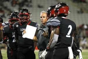 Langham Creek High School head coach Todd Thompson talks to players during the first half of a high school football game between Fort Bend Bush and Langham Creek, Thursday, September 6, 2018, at Cy-Fair FCU Stadium.