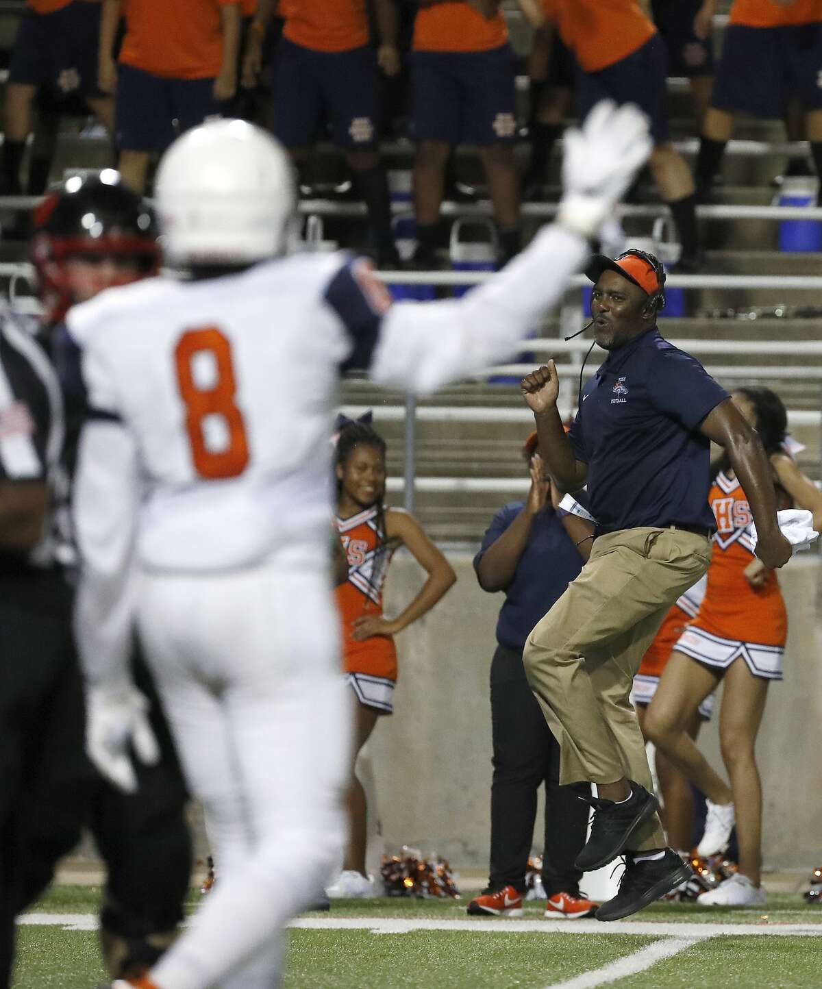 A George Bush coach dances as he celebrates the defense putting a stop on Langham Creek during the second half of a high school football game between Fort Bend Bush and Langham Creek, Thursday, September 6, 2018, at Cy-Fair FCU Stadium.