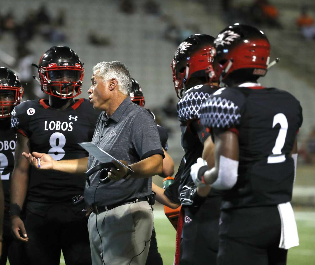 Langham Creek High School head coach Todd Thompson talks to players during the first half of a high school football game between Fort Bend Bush and Langham Creek, Thursday, September 6, 2018, at Cy-Fair FCU Stadium.