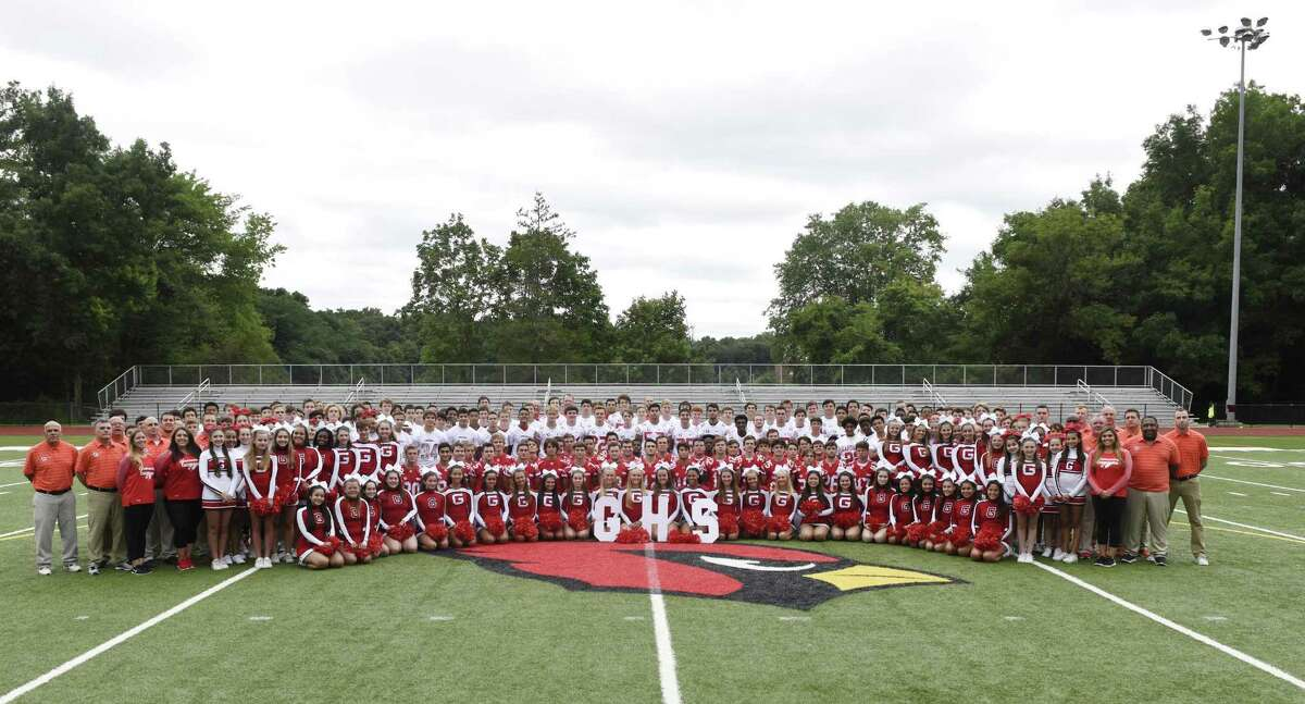 The 2018 Greenwich High School football team, coaches and cheerleaders pose for a team photo on media day at Greenwich High School's Cardinal Stadium in Greenwich, Conn. Sunday, Aug. 19, 2018.