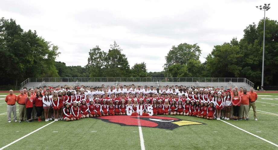The 2018 Greenwich High School football team, coaches and cheerleaders pose for a team photo on media day at Greenwich High School's Cardinal Stadium in Greenwich, Conn. Sunday, Aug. 19, 2018. Photo: Tyler Sizemore / Hearst Connecticut Media / Greenwich Time