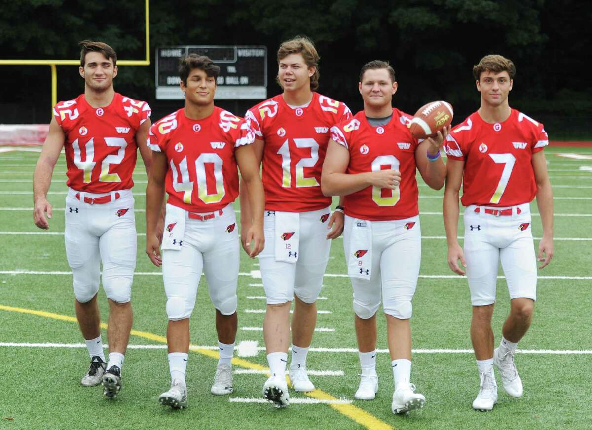 Greenwich High School 2018 football team captains Gramoz Bici (42), Tysen Comizio (40), Gavin Muir (12), Jack Feda (8), and Charlie Ducret (7) pose on media day at Greenwich High School's Cardinal Stadium in Greenwich, Conn. Sunday, Aug. 19, 2018.