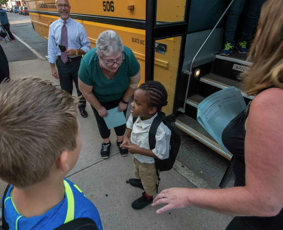 Take a look through the slideshow above of photos of first days of school in past years by Times Union photographers. Pre-K student Jacob Taylor, 5, gets assistance getting to class on opening day at the Hamilton Elementary School Sept. 6, 2018 in Schenectady, N.Y. (Skip Dickstein/Times Union)
