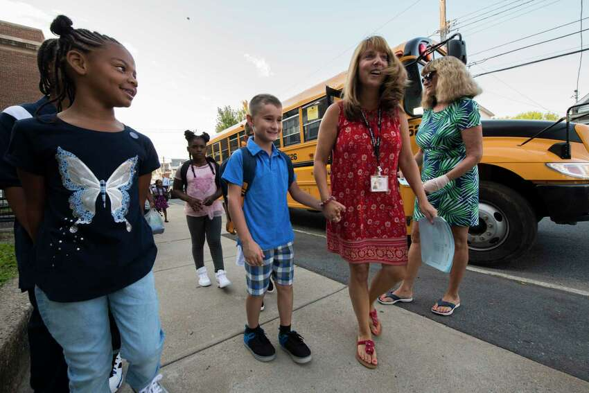 Teachers guide arriving students to their new classrooms on opening day at the Hamilton Elementary School Sept. 6, 2018 in Schenectady, N.Y. (Skip Dickstein/Times Union)