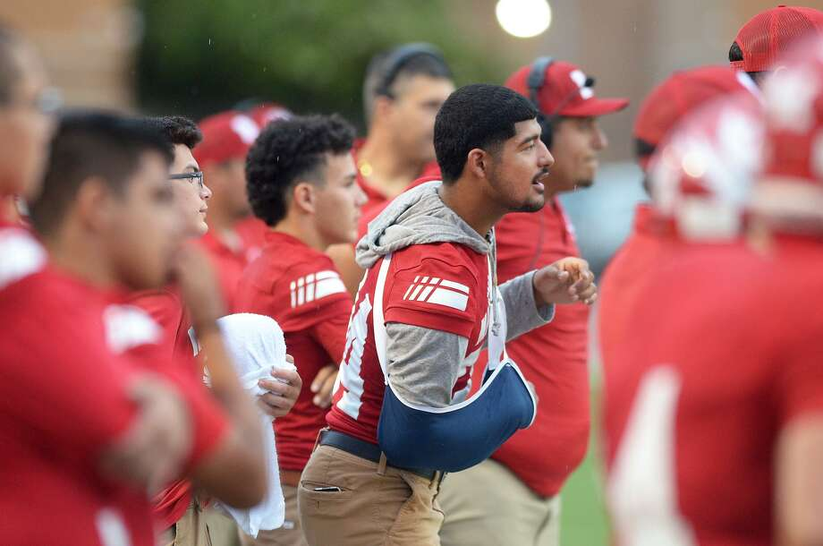Injured quarterback Mathew Duron follows the action from the sidelines as the Tigers faced off against Carrizo Springs, Thursday, September 6, 2018, at Shirley Field. Photo: Cuate Santos /Laredo Morning Times / Laredo Morning Times