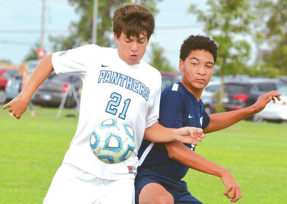 Jersey's Zachary Schaefer, left, tries to control the ball against Andrew Nwacha of Father McGivney High School during Thursday's game in Glen Carbon. Jersey won 2-1. Photo: Scott Marion | For The Telegraph