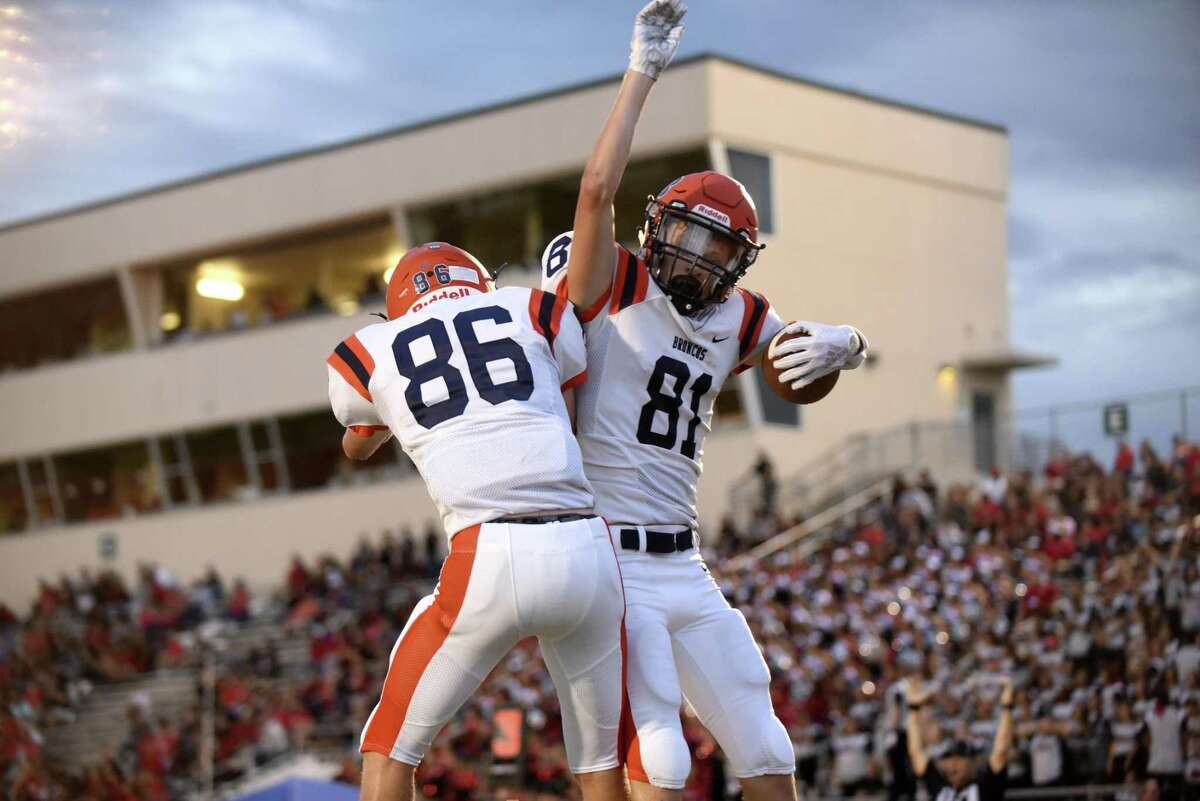 Brandeis receiver Brandon Pake (81) celebrates with teammate Brock Gallegos after scoring a first-half touchdown against Stevens during boys football action at Gustafson Stadium on Thursday, Sept. 6, 2018.