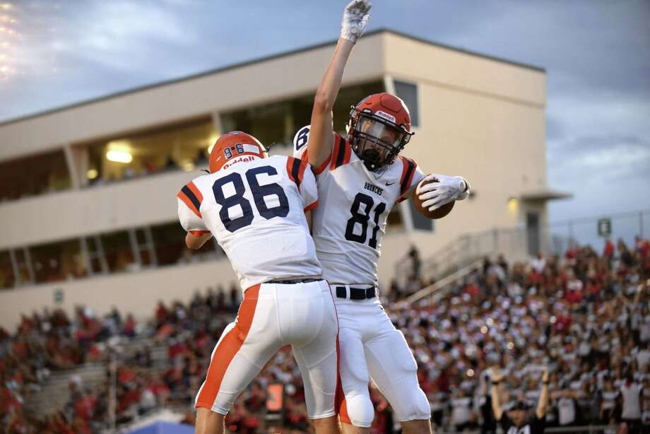 Brandeis receiver Brandon Pake (81) celebrates with teammate Brock Gallegos after scoring a first-half touchdown against Stevens during boys football action at Gustafson Stadium on Thursday, Sept. 6, 2018. Photo: Billy Calzada / Staff Photographer / San Antonio Express-News