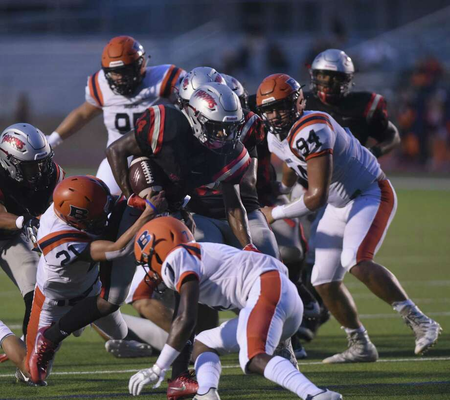 Stevens running back Clarence Lee runs for a first-half touchdown against Brandeis defenders during boys football action at Gustafson Stadium on Thursday, Sept. 6, 2018. Photo: Billy Calzada / Staff Photographer / San Antonio Express-News