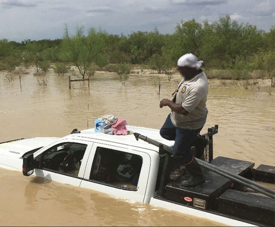 Border Patrol agents and Webb County Volunteer Fire Department personnel helped rescue four individuals stranded during a recent flooding southwest of Catarina. The individuals, employed by various energy companies, were transported to a safe area to be evaluated by emergency medical services. Photo: Courtesy Border Patrol
