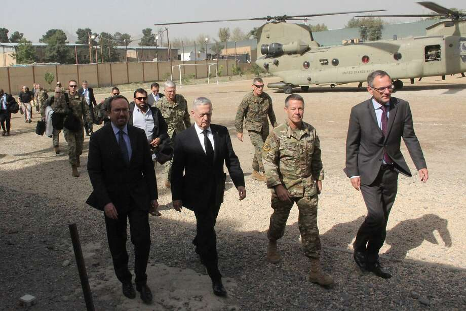 US Defense Secretary Jim Mattis (2nd L) arrives at NATO's Resolute Support mission in Kabul on September 7, 2018. - Mattis landed in Kabul on September 7 for an unannounced visit to war-torn Afghanistan, adding his weight to a flurry of diplomatic efforts to bring the Taliban to the negotiating table. (Photo by Thomas WATKINS / AFP)THOMAS WATKINS/AFP/Getty Images Photo: THOMAS WATKINS;Thomas Watkins / AFP / Getty Images