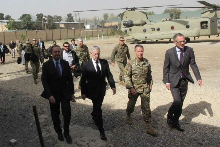 U.S. Defense Secretary Jim Mattis (2nd L) arrives at NATO's Resolute Support mission in Kabul on Sept. 7, 2018. Mattis landed in Kabul for an unannounced visit to war-torn Afghanistan, adding his weight to a flurry of diplomatic efforts to bring the Taliban to the negotiating table.
