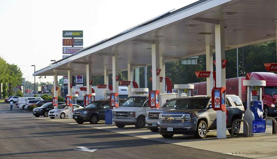 Motorists fill up at the pumps at the Darien Travel Plaza along the I-95 corridor on Aug. 29. Travelers can endure expected delays in the region as the unofficial end of summer Labor Day weekend approaches. Photo: Matthew Brown / Hearst Connecticut Media / Stamford Advocate