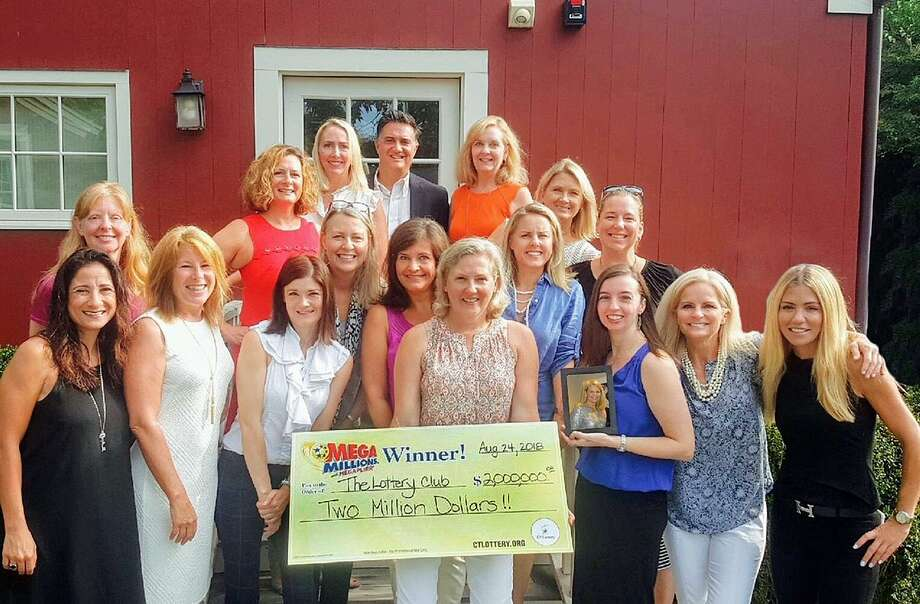 "The ""Lottery Club"" Al Filippone Associates at William Raveis Real Estate in Fairfield shate their $2 million CT Lottery prize win on Thursday, Sept. 6, 2018. From bottom row to top, left to right are: Gina Hackett, Libby Tritschler, Liz Lewis, Karen Cross, Susana Chuka, Amy Desel, Christa Cusano, Leann Ratner, Pam Foarde, Vicki Ihlefeld, Wendy Ryan, Amie Lindwall Belile, Nicole Farrell, Amy Hios, Kelli Montinaro, Bob Manware, and Tracie Rigione. Photo: Contributed Photo /The Lottery Club"