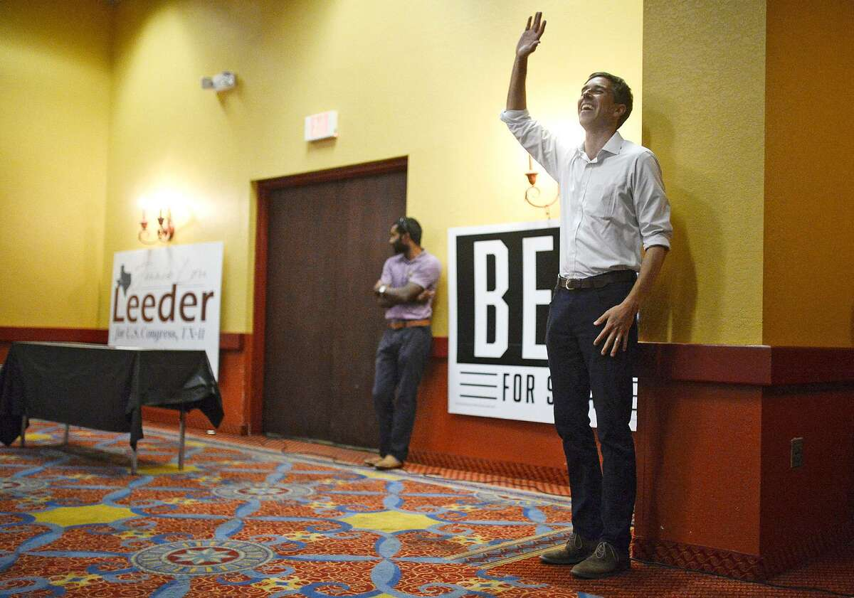 U.S. Rep. Beto O'Rourke, D-El Paso, waves to a crowd of supporters before speaking at a town hall event at the Grand Texan Hotel Convention Center Thursday, Aug. 30, 2018, in Midland, Texas. O'Rourke, the Democratic candidate for the U.S. Senate and incumbent Republican Sen. Ted Cruz will face off in the general election in November. (James Durbin/Reporter-Telegram via AP)