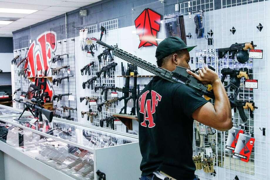 File photo of a gun store. Photo: Michael Ciaglo, Staff Photographer / Michael Ciaglo