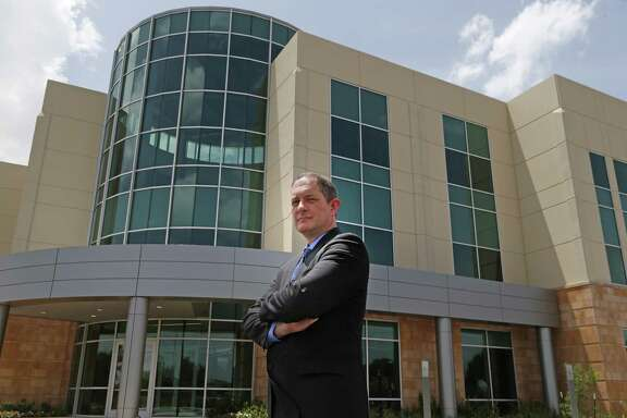 """Port San Antonio CEO Jim Perschbach poses in front of the new """"Project Tech"""" cybersecurity office space building. Photos taken on Monday, Aug.13, 2018."""
