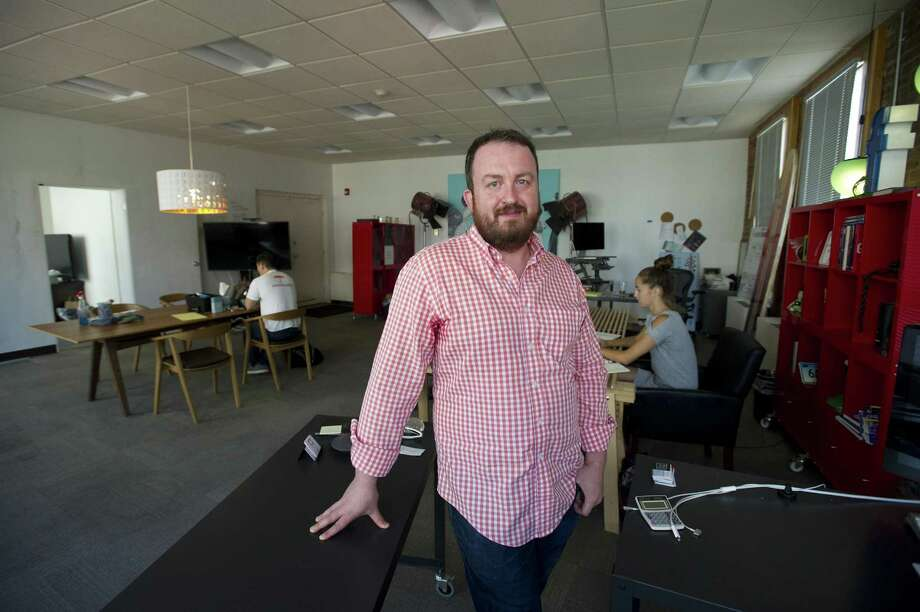 Jonathan Winkel, managing partner of the SquareWheel marketing agency and founder of Stamford Innovation Week, stands inside the company's office at 1 Bank St., in downtown Stamford, Conn., on Tuesday, Sept. 4, 2018. Photo: Michael Cummo / Hearst Connecticut Media / Stamford Advocate