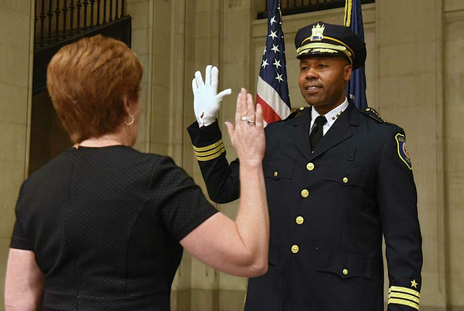 Albany Mayor Kathy Sheehan swears in new Albany Police Chief Eric Hawkins at Albany City Hall on Friday, Sept. 7, 2018 in Albany, N.Y. (Lori Van Buren/Times Union) Photo: Lori Van Buren, Albany Times Union / 20044747A