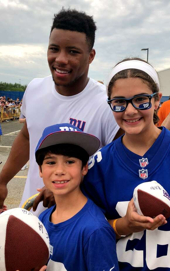 The author, her brother, Charlie Jimenez, and Giants running back Saquon Barkley, at Giants training camp in New Jersey. Photo: Contributed Photo / Connecticut Post Contributed