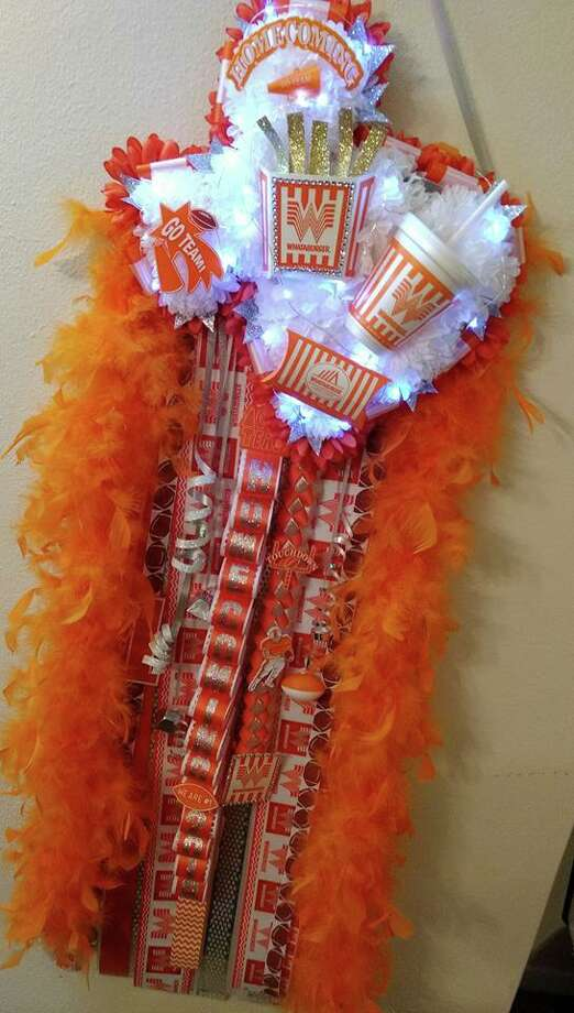 "PHOTOS: Texas man creates ""Whatamum"" Adrian Michael Alaniz, who owns an event planning business in Sinton, created a Whataburger-themed mum this week to attract business.>>>Get a closer look at the creation  Photo: Adrian Michael Alaniz/Facebook"