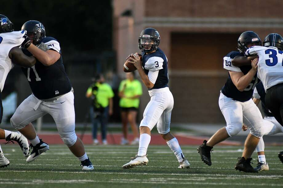 Kingwood junior quarterback Grant Wall (3) enjoys a clean pocket provided by Mustang offensive linemen Matt Venezia (71), a senior, and junior Lucas Borders, right, during the quarter of their matchup at Turner Stadium in Humble on Sept. 6, 2018. Photo: Jerry Baker, Houston Chronicle / Contributor / Houston Chronicle
