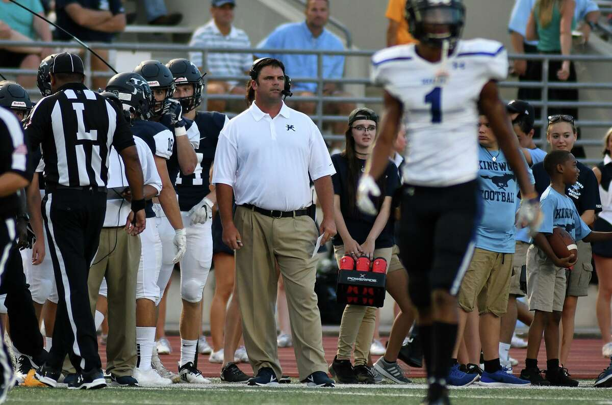 Kingwood Head Coach Barry Campbell, center, watches his team work against Dekaney during the first quarter of their matchup at Turner Stadium in Humble on Sept. 6, 2018.
