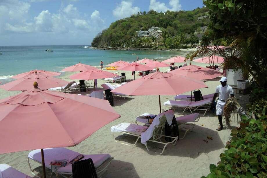 The beach at BodyHoliday St. Lucia offered good swimming, relaxing and snorkeling. (Doug Hansen/San Diego Union-Tribune/TNS) Photo: Doug Hansen / San Diego Union-Tribune